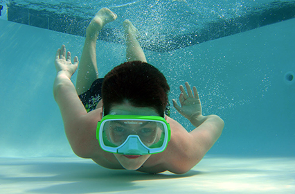 Paul Van Allen photo of boy underwater with swim mask