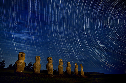 Katsu Tanaka photo of moai of easter island and star trails in the sky